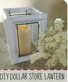 Buy 4 dollar store black frames..spray paint white..insert black tape inside for framing of glass and glue all four sided together..insert candle..instant hurricane candle holder..great for a beach theme decor :)