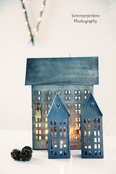 Loving these little houses. Pottery Houses, Ceramic Houses, Lantern Candle Holders, Candle Lanterns, Tin House, Paper Houses, Art Houses, Chandeliers, Blue Christmas