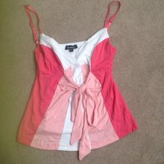Bebe top Bebe..size small...like new..adjustable straps..pink and white with tie on front bebe Tops