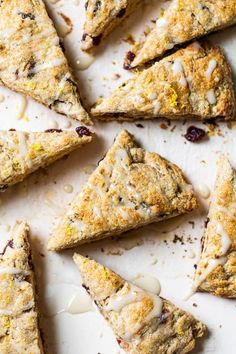 These Lemon Cranberry Scones studded with dried cranberries are topped with a lemon glaze; a perfect Sunday morning treat. #scones #breakfast