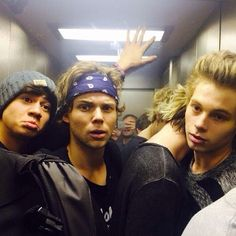 5 Seconds of Summer<<<It's like Calum is giving Ash the puppy dog face because he wants to cuddle like Luke and Michael haha