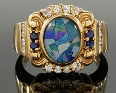 """There are some minor scratches on the ring.<br/><br/>Featured here is an elegant Laura Ramsey Opal and CZ vermeil ring. Stone: Opal, CZ. Metal: Gold over Sterling Silver. Top Dimension: 5/8"""". Shank Dimension: 1/16"""". Stamp: 925, LR, China. There are some minor scratches on the ring. 