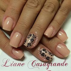 A very pretty nude nail art design with flower details on it. The flowers are painted in light strokes of black polish and they fit perfectly with the subtle color of nude as its base.