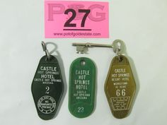 """Lot 27 in the 3.4.14 online & live auction. Great collection of three vintage key fobs, one has a skeleton key attached, for rooms at the once great Castle Hot Springs Resort Hotel. Each fob measures about 3.5"""" long. - Gold fob, room 66, with skeleton key. The key has some minor oxidation. - Green fob, room 2. - Green fob, room 23. #Arizona #History #POGAuctions"""