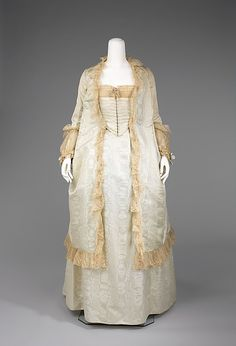 Tea gown Date: 1875–80 Culture: probably American Medium: silk, cotton Dimensions: Length at CB (a): 44 1/2 in. (113 cm) Length at CB (c): 49 1/2 in. (125.7 cm) Credit Line: Brooklyn Museum Costume Collection at The Metropolitan Museum of Art, Gift of the Brooklyn Museum, 2009; Gift of Mrs. Frederick H. Prince, Jr., 1967 Accession Number: 2009.300.3856a–c