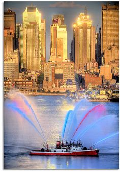 NYC - this is a Special Occasion, because the fire boats are out & putting on quite a show!
