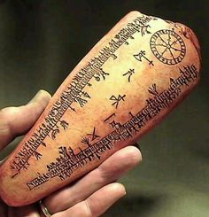 A bone seeing tool. Notice the sun wheel and axe of Thor. The rune filled perimeter represents the lands of the living and the dead. This type of instrument was also very common among the Sami (Lapps) and has shamanistic origins.