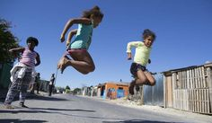 Photo: Children play in Happy Valley, Cape Town, South Africa, 05 May 2016. Happy Valley in the greater Blue Downs area is one of the poorest communities on the Cape Flats an area dubbed the apartheid dumping ground. EPA/NIC BOTHMA
