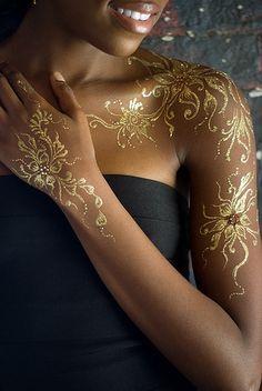 Dark skin tattoo on pinterest skin color tattoos dot for Gold ink tattoos