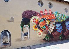 Street Artist Decorates Walls With Colorful, Mythical Creatures - DesignTAXI.com