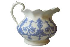 Elegant large queensware pitcher with blue scrolls and medallions all around. Circa 1850. No maker's marks.