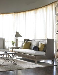 Not usually a big fan of leather couches (they are too cold when you first sit down), but this Lillian August couch...Yes please!  And I'd take that linen chair in the corner too.