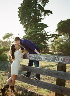 Chalk on the fence. Adorable save the date idea!