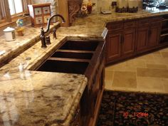 Granite Countertops traditional kitchen countertops Absolute Cream.  Like this color of countertop if I have to keep my natural wood cabinets