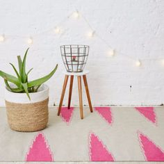 Staggered Chevron Rug - Small: A beautiful handmade flat woven rug from Holly's House own collection designed by Holly Vaughan and Tansy Haak.   - Hand woven - Vibrant pink chevron design on a neutral background
