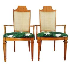 """A pair of vintage armchairs with  refurbished with new light caning and reupholstered in a tropical """"swaying palms"""" fabric. These chairs would look fab at the ends of a dining table or in a living room setting."""