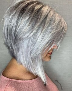 Steeply Angled Silver Bob with Layers A sleek inverted bob in bright silver is an eye-catcher in any age. The straight hair is parted on the side and has long wispy feathered bangs. If you don't mind some drama in modern haircuts to keep you loo Long Bob Haircuts, Modern Haircuts, Short Bob Hairstyles, Pixie Haircuts, Wedding Hairstyles, Braided Hairstyles, Celebrity Hairstyles, Modern Bob Haircut, Boy Haircuts