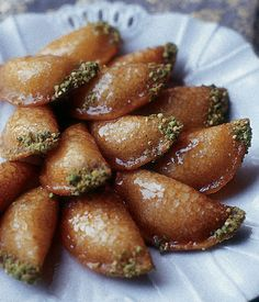 'Ataiyef - Stuffed Syrian Pancakes   'Ataiyef is not your ordinary Sunday morning pancake. Filled with ricotta cheese, deep-fried, dipped in chopped pistachio nuts, and topped with shira (Fragrant Aleppian Dessert Syrup), it is more like a five-star dessert. Aleppian Jews eat 'ataiyef on happy occasions such as engagement parties. #saltstudionyc