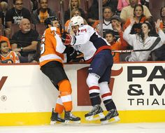 20c991ae2be CrowdCam Hot Shot  Washington Capitals right wing Joel Rechlicz checks  Philadelphia Flyers center Chris Vande