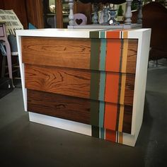 Mid Century Modern chest painted with Chalk Paint® by Annie Sloan in Pure White, with Olive, Provence, Barcelona Orange, and Arles stripes over drawers stained in ombre using General Finishes Gel Stains in Nutmeg, Candlelight, and Java. By Jen's Furniture Rehab
