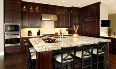Cherry Cabinets and St. Cecilia granite - dark wood floors