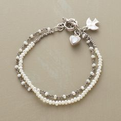 """PEARL ARTISTRY BRACELET--Our exclusive two-strand bracelet intermingles cultured freshwater pearls with sterling links and seed beads. A mother of pearl heart dangles  from the toggle clasp. Handmade in USA. Approx. 7-1/2""""L."""
