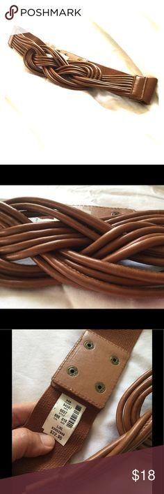 NWT New York & Co. Infiniti Braided Belt in L/XL Beautifully braided and looped in a Cognac color and has Elastic Stretch to fit most sizes.  New and never worn, the color looks great with anything New York & Company Accessories Belts