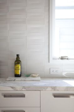 Lovely kitchen detail. This mix of whites is pretty appealing to me.