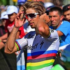 Peter Sagan, wearing the rainbow-striped jersey of the World Road Race Cycling Champion.
