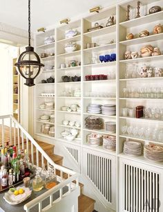 Antique Wedgwood and Coalport china is stored in the pantry of a Hudson Valley, New York, home.