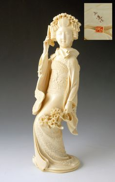 Japanese ivory okimono of a Bijin holding sakura flowers (1868 to 1912 Japan)