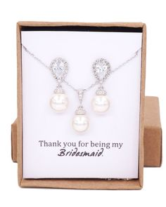 Silver tone ( rhodium plated) Teardrop Cubic Zirconia ear posts. 925 sterling silver posts. Swarovski Pearl drops (10mm). High quality rhodium finished. Nickel Free.  ✦ Length: Around 1 inch  MESSAGE: - CUSTOM NOTE IN BOX: please let me know during check out; or - Choose one of the pre-printed cards (last picture)[Outside box]  ✦ Beautifully gift wrapped in gift box with ribbon. Perfect to keep or give.  ✦ Thank you for visiting / shopping at Glitz & Love! http://www.glitza...