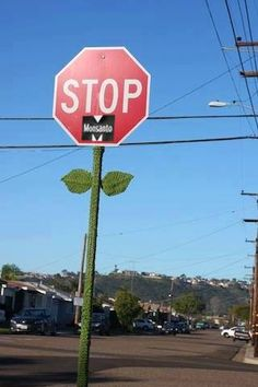 "Artists Against Monsanto - Genius! - Bryan ""The Knitting Guy"" is on a wicked mission to turn as many Stop signs into flowers as he can... In Clairemont, California, he did this to at least a hundred signs..."