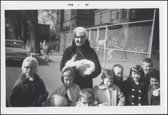 Every bunny loves a sister! This photo features Sister Mary Ann Phelan and students from St. Patrick's School in Clinton, Iowa fifty years ago.