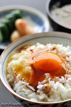 Tamago kake gohan is a popular Japanese breakfast food consisting of cooked rice topped or mixed with raw egg and soy sauce.