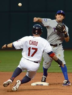 CLEVELAND, OH - MAY 4: Shin-Soo Choo #17 is out at second as second baseman Ian Kinsler #5 of the Texas Rangers throws to first for a double play during the fourth inning of the Cleveland Indians  at Progressive Field on May 4, 2012 in Cleveland, Ohio. (Photo by Jason Miller/Getty Images) game 26