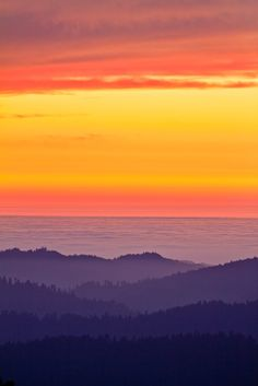 Loving Those Layers    Sunset over the foggy Pacific Ocean in Mendocino County, Northern California by Chris Hansen