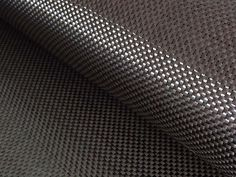 Carbon fiber is five time stronger than steel. It is light weight and easy to work with. This article is all about carbon fiber, read on to know more. Fibre And Fabric, Woven Fabric, Bean Bag Design, Aircraft Interiors, Back To Black, Black Fabric, Carbon Fiber, Cool Stuff, Facts