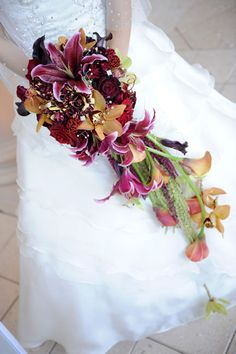 Cymbidium, calla lily, rose, and lily bouquet