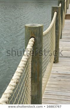 Boardwalk with Rope Railing - posts are too big but the concept without the nett. Boardwalk with R Rope Fence, Rope Railing, Deck Railings, Lake Dock, Boat Dock, Lake Landscaping, Seaside Garden, Outdoor Decor, Boathouse