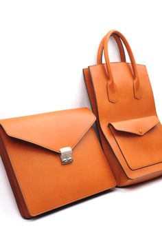 Orange leather document case and shopper.