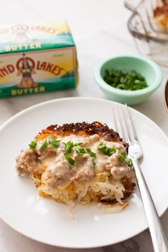Potato Casserole with Sausage Gravy: This is slow comfort food at its best. Homemade simple potato casserole with fresh potatoes topped with sausage gravy!