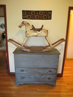 Early rocking horse on early blue mule chest
