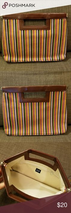 Gap Clutch Very cute and bright Gap clutch.  Made with striped cotton fabric and a leather look trim.  Cotton lining, with no marks, with an interior zippered pocket.  The opening is hinged to stay open. GAP Bags Clutches & Wristlets