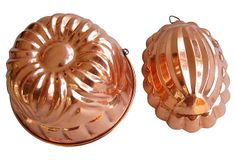 """1950s Copper Molds, Pair on OneKingsLane.com 1950s Copper Molds, Pair $149.00  ($249.00 Estimated Market Value) Era: Vintage Condition: Very Good; some scuffs, wear, dings,  larger mold replaced wire hanging ring Two 1950s copper molds with rings for displaying. Smaller mold, 6.5""""L x 4.75""""W x 2.75""""H. Larger mold is unmarked, smaller mold is marked """"Made in Portugal."""""""