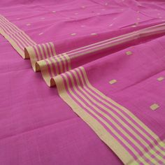 #paaduka #buysarisonline #Handwoven Lotus Pink Cotton Sari with Striped Border ~ Once again, an alluring lotus pink sari in handwoven cotton. Subtly contrasted with beige buttas on body and pallu, and stripes on the border, this sari is summery and smart. Sari code: 780511820