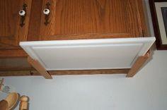 Under cabinet cutting board storage - kitchen organization - small spaces
