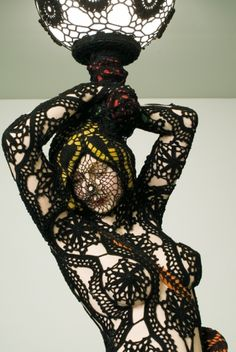 This is crocheted art form.  A pole wrapped in this black and white would be a stunner!