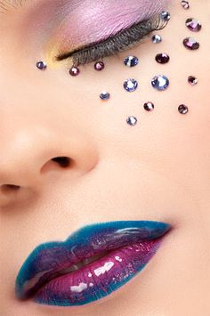 Lavender eye shadow with creatively placed crystal accents and cool purple and blue shiny lips.