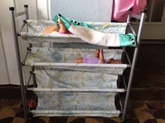 $20.00 baby doll bunk beds. Walmart shoe rack, marked down fabric and no sew glue. I will go back and sew seams when I have a machine.
